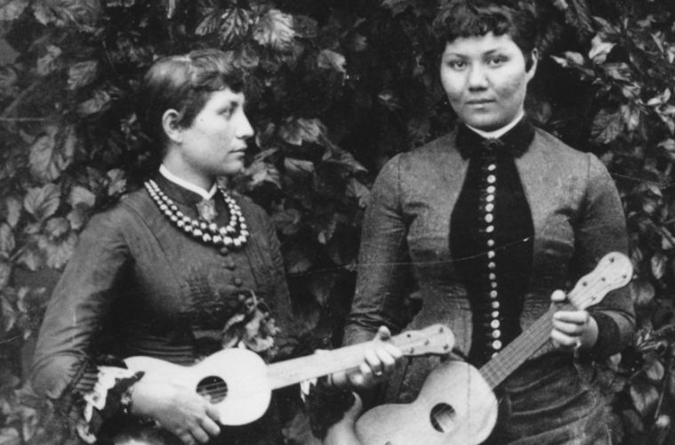 Maria Lane of Honolulu and friend pose with five-string taropatches strung as ukuleles, ca. 1891–1892