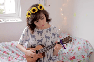 "Dodie Clark plays the Beatle's ""Here Comes the Sun"" on ukulele."