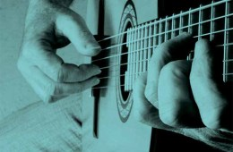 blue classical guitar close up on fingers