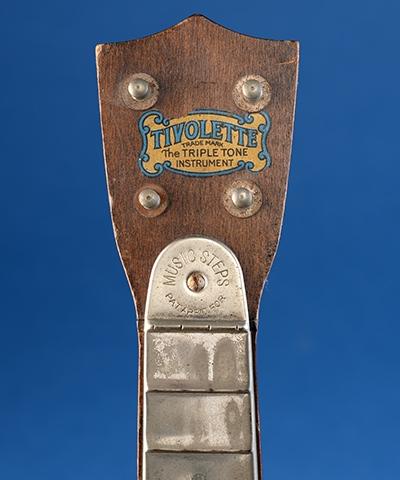 Tivolette banjo uke with stamped patent application notice