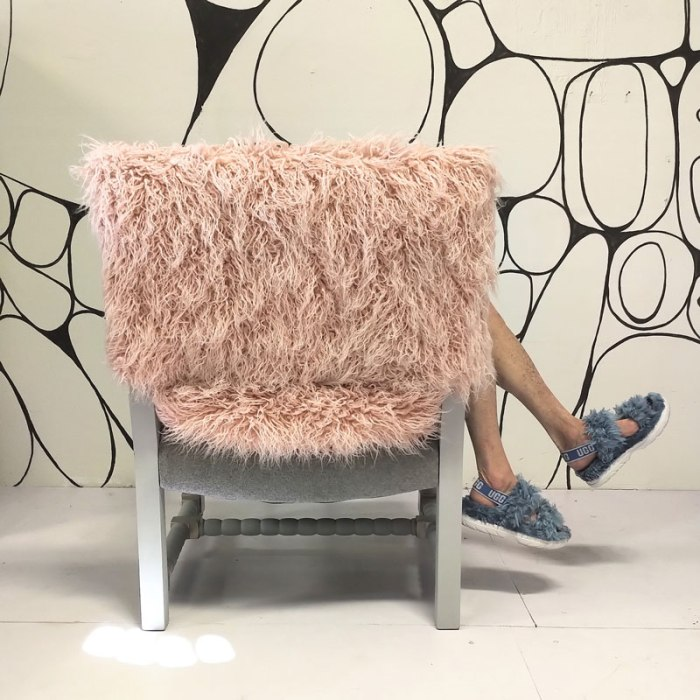Goldie in Curls chair with pink faux sheepskin covering