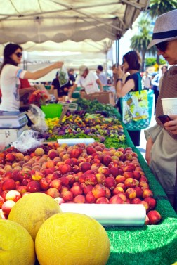 Buyers getting their weekly portion of fresh and healthy at the Santa Monica Farmer's Market.  August 7, 2013.