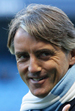 Manchester City manager Roberto Mancini gives the thumbs up