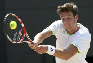 Gianluigi Quinzi of Italy hits a return to Chung Hyeon of South Korea during their boy's singles final tennis match at the Wimbledon Tennis Championships, in London