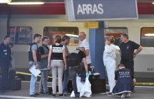 Criminal and forensic investigators put on protective suits on a platform next to a Thalys train of French national railway operator SNCF at the main train station in Arras, northern France, on August 21, 2015. A gunman opened fire on a train travelling from Amsterdam to Paris, injuring three people before being overpowered by passengers, French state rail company SNCF and rescue services said. Two of the victims were seriously injured and at least one suffered gunshot wounds, an SNCF spokesman said, adding that the assailant was armed with guns and knives. The motives behind the attack were not immediately known. AFP PHOTO / PHILIPPE HUGUEN        (Photo credit should read PHILIPPE HUGUEN/AFP/Getty Images)