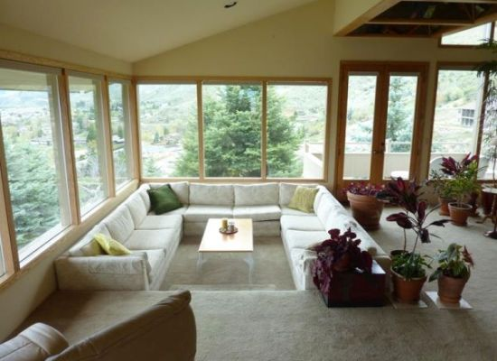 Simple sunken living room with white firniture and big glass windows - NO.1# BEAUTIFUL SUNKEN LIVING ROOM DESIGN IDEAS