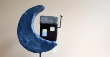 Make a paper mache house sculpture