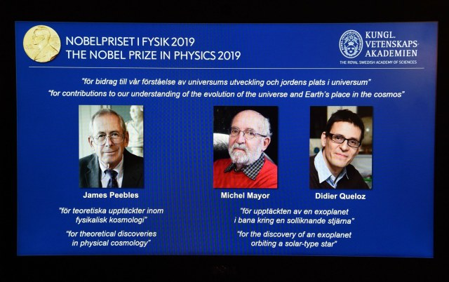 A computer screen displays the portraits of the laureates of the 2019 Nobel Prize in Physics CanadianAmerican James...