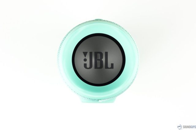 Pictured is the teal JBL Charge 3 Bluetooth speaker with the JBL logo on the passive radiator facing up on a white background.
