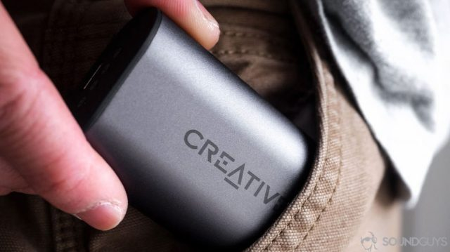Creative Outlier Air: The earbuds case being removed from a pocket.