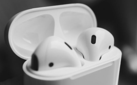 Close-up of AirPods in a charging case