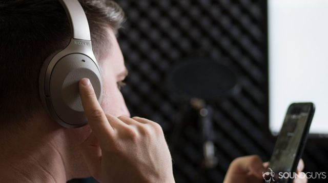 A photo of the Sony WH-1000X M2 wireless Bluetooth headphones being used to activate the Google Assistant on a Google Pixel XL.