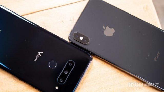 An aerial photo of an LG V40 ThinQ in black next to an Apple iPhone XS Max in space grey.