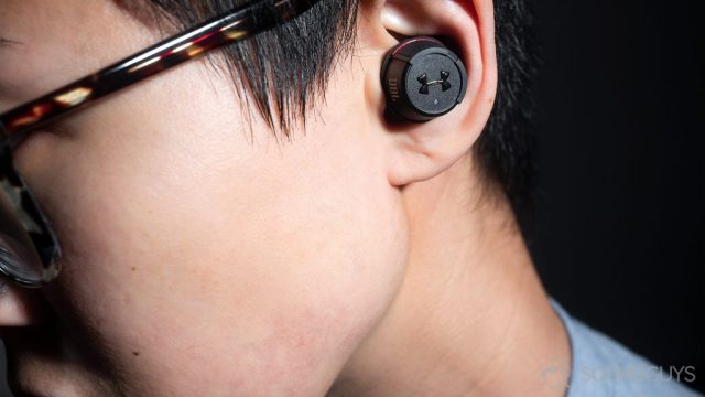 AirPods alternatives - Under Armour True Wireless Flash JBL: A woman wearing the earbuds.