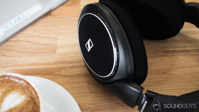 Sennheiser headphones HD 598 CS review: A cappucuino in the bottom-left corner of the image, the trackpad portion of a Microsoft Surface Book in the top-left corner, and the headphones taking up the right section of the image.