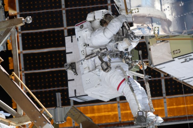 Jessica Meir spacewalking fixing an ISS power system