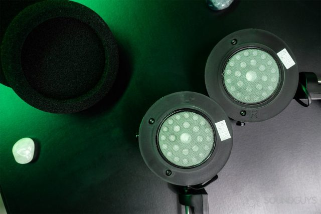 Grado GW100: Top-down image of the ear cups unsheathed with the ear pads off to the side on the upper left hand corner.
