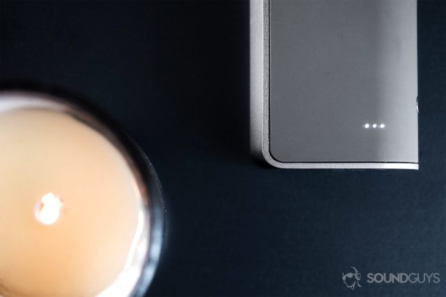 Overhead image of the A picture of the RHA TrueConnect true wireless earbuds LEDs on the charging case.