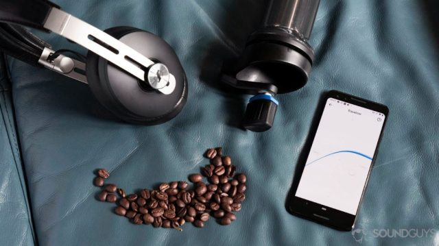 Angled aerial photo of the Sennheiser Momentum Wireless 3 headphones next to Google Pixel 3 with the Smart Control app EQ open next to a coffee grinder and beans.