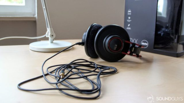 A photo of the AKG K7XX on a desk with the long cable wrapped up in the foreground.