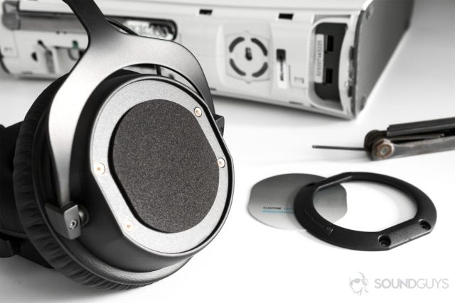 Beyerdynamic CUSTOM Game: The headphones are angled off to the side, unsheathed to replace the ear cup plates.