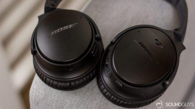 Pictured are the controls of the Bose QuietComfort 35 II with the headphones on a couch.
