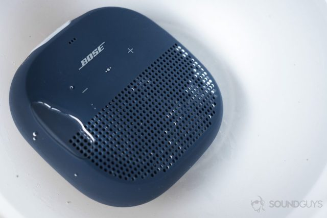 The Bose SoundLink Micro (blue) underwater (white background)