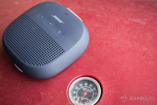 SoundLink Micro on a red grill with the thermometer showing.