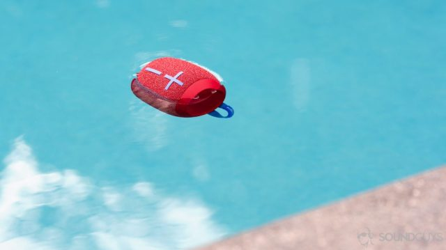 The UE Wonderboom 2 floating in a pool. The speaker is in red.