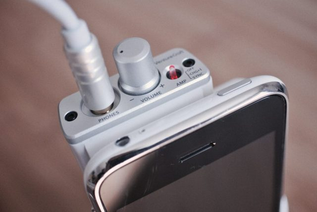 A photo of a headphone amplifier attached to a smartphone, shot by Flickr user mujitra.