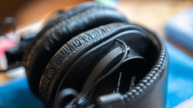 Close-up of dirty Sony MDR-7506 headphones with specs of dust in it, before they become clean headphones.
