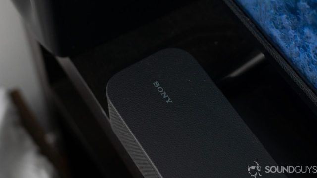 Close-up of sony logo on the Sony HT-S350 soundbar in front of the TV