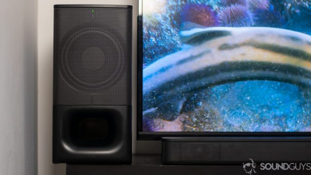Sony HT-S350 subwoofer and soundbar pictured next to a TV on a black stand.