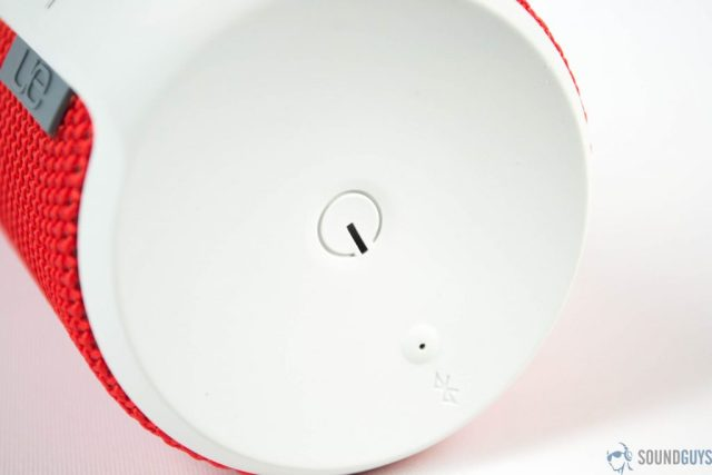 Close-up shot of the power button and the Bluetooth pairing button on the top of the speaker.