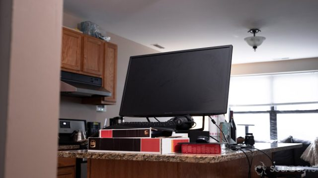 A picture of a desk setup on a kitchen counter with a monitor to show how to work from home with limited space.
