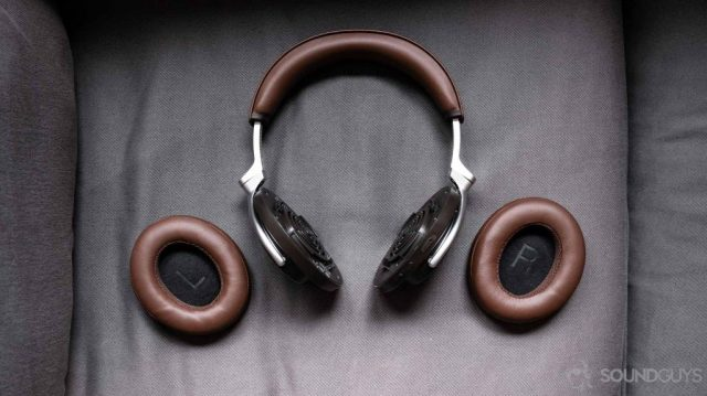 An aerial picture of the Shure Aonic 50 noise cancelling headphones with the ear pads removed and to the side.