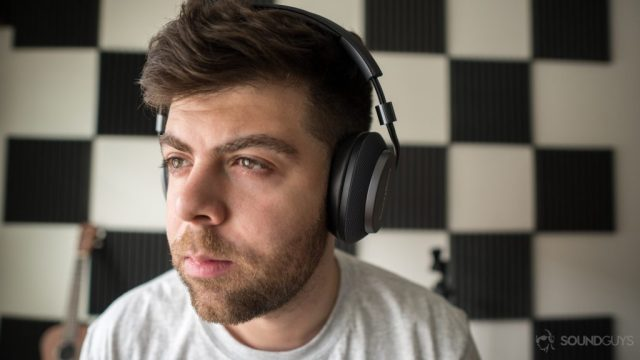 Wearing the Bowers & Wilkins P5 Wireless over-ear headphones.