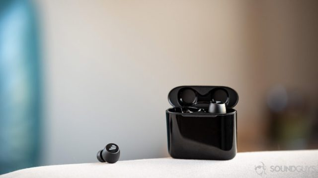 A picture of the Edifier TWS6 true wireless earbuds in black on a couch arm.