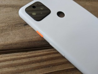 3.5mm headphone jack on top and fingerprint reader on the back