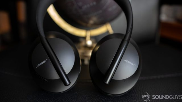 A picture of the Bose Noise Cancelling Bluetooth Headphones 700 on black surface.
