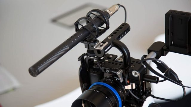 A picture of the Rode NTG4+ mounted on top of a camera.