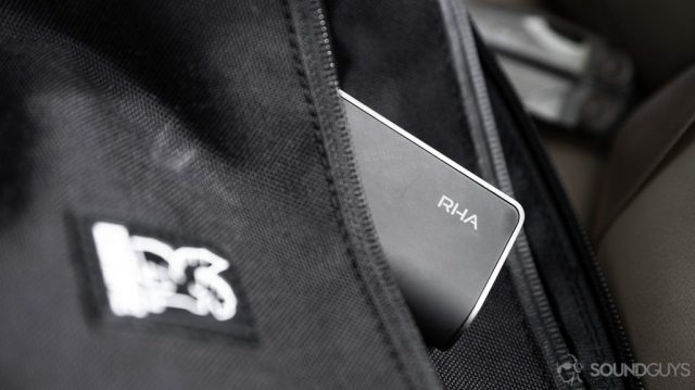 A picture of the RHA TrueConnect 2 true wireless charging case peaking out from a bag's pocket.