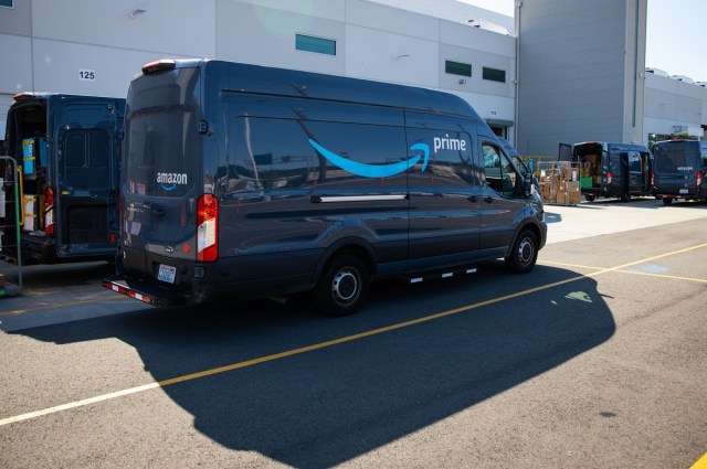 Amazon's delivery trucks being loaded