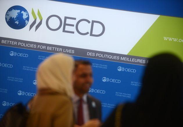 OCDE: 130pays s'engagent à réviser les règles mondiales de fiscalité pour les entreprises