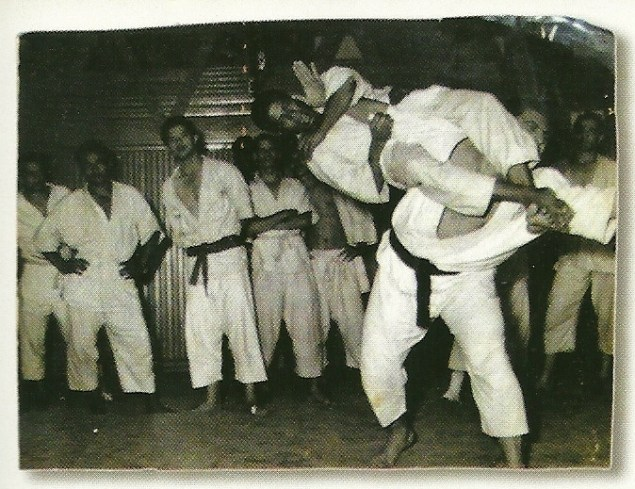 One of Oswaldo Fadda's students demonstrates a flying arm-lock in his academy in the slums of Rio.