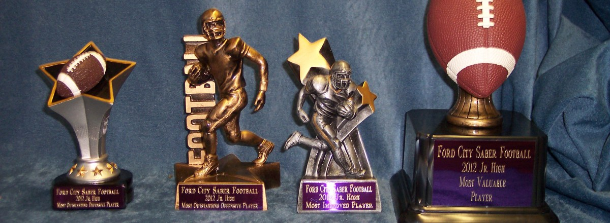 four specialty football trophies