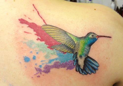Watercolor-hummingbird-back-tattoo