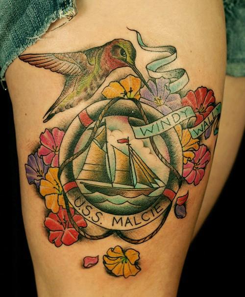 hummingbird-flower-and-boat-thigh-tattoo