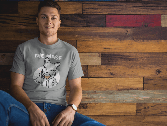 man-wearing-a-tshirt-mockup-while-sitting-against-a-wooden-wall