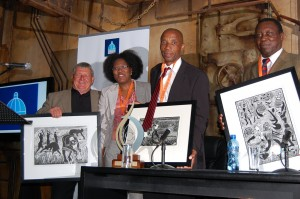 The panelists receive their award from Tebogo Mzizi, Senior Manager: Libraries